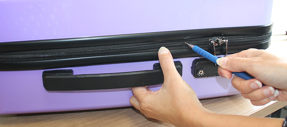 Opening suitcase with a pen